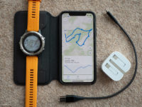 Photo of an iPhone XS next to a Garmin Fēnix 5 Plus
